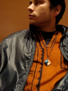 rich wears amazonic dashiki and rock carving cuzco symbol